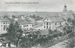 Il difficile primo dopoguerra a Sedico. La guerra è appena terminata. Resta, al centro della foto, la baracca costruita dagli austriaci